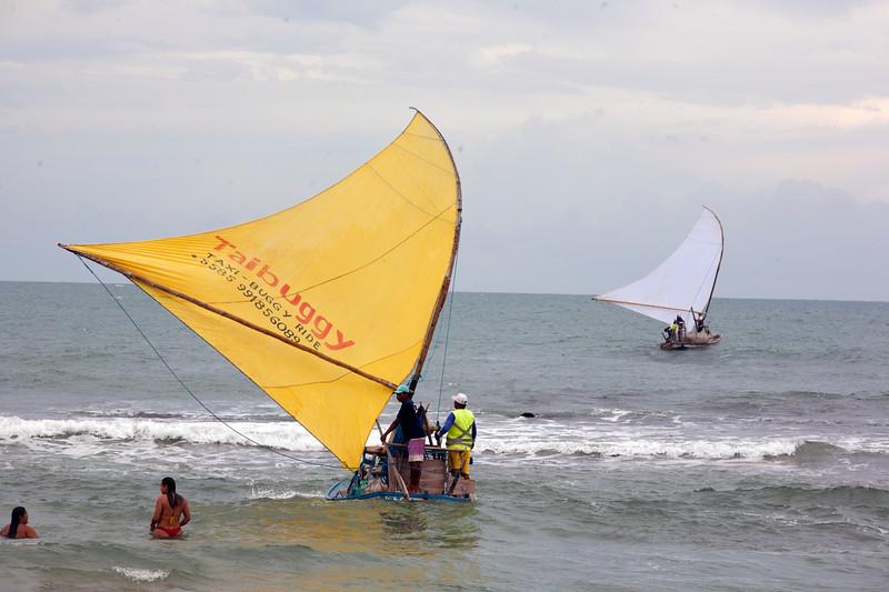 Fishermen head out to sea outside of Fortaleza, Brazil.