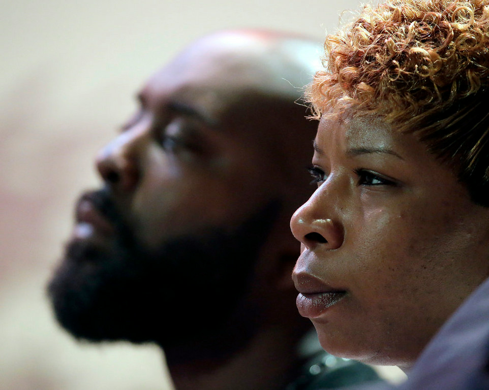 . Parents of Michael Brown, Michael Brown Sr. and Lesley McSpadden listen to a speaker during a rally, Sunday, Aug. 17, 2014, for their son who was killed by police last Saturday in Ferguson, Mo. Brown\'s shooting in the middle of a street, following a suspected robbery of a box of cigars from a nearby market, has sparked a week of protests, riots and looting in the St. Louis suburb. (AP Photo/Charlie Riedel)