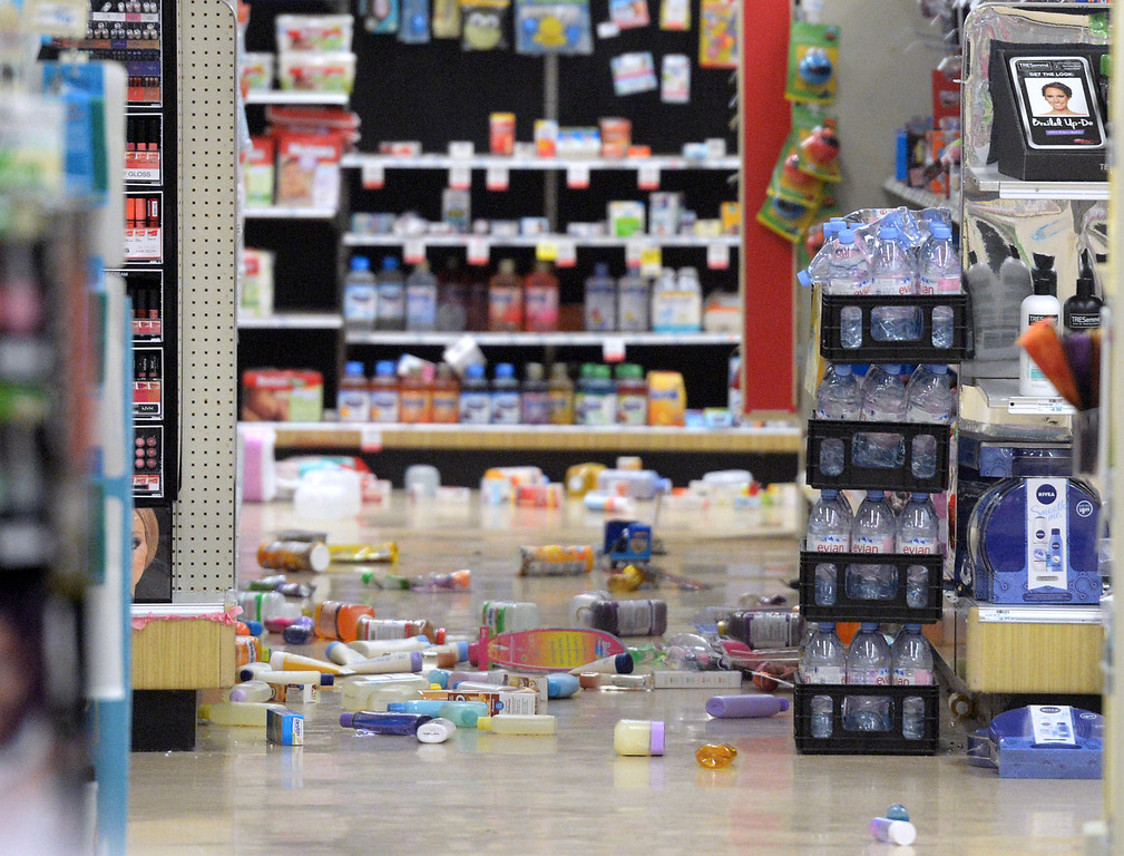 . Merchandise covers the floor after the 5.1 eartchquake at at the CVS store in La Habra on Friday March 28, 2014. (Staff Photo by Keith Durflinger/Whittier Daily News)