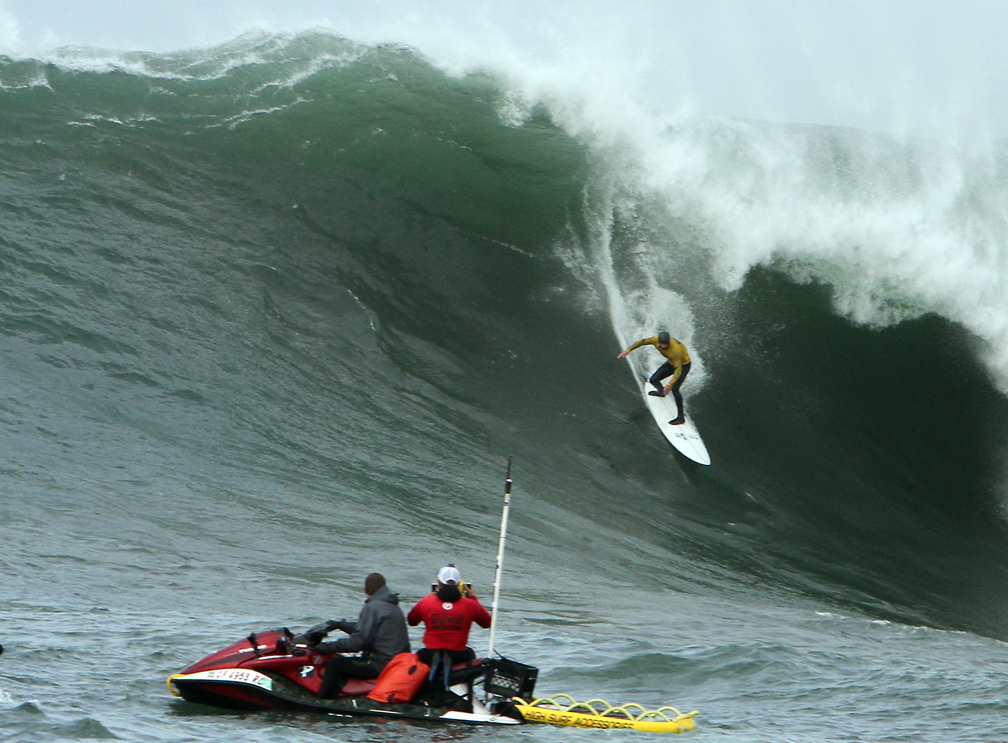 . Shawn Dollar impresses the crowd during his semifinal heat as he cuts through a colossal wave during the Maverick Invitational big wave surfing competition in Half Moon Bay on Friday. (Kevin Johnson/Sentinel)