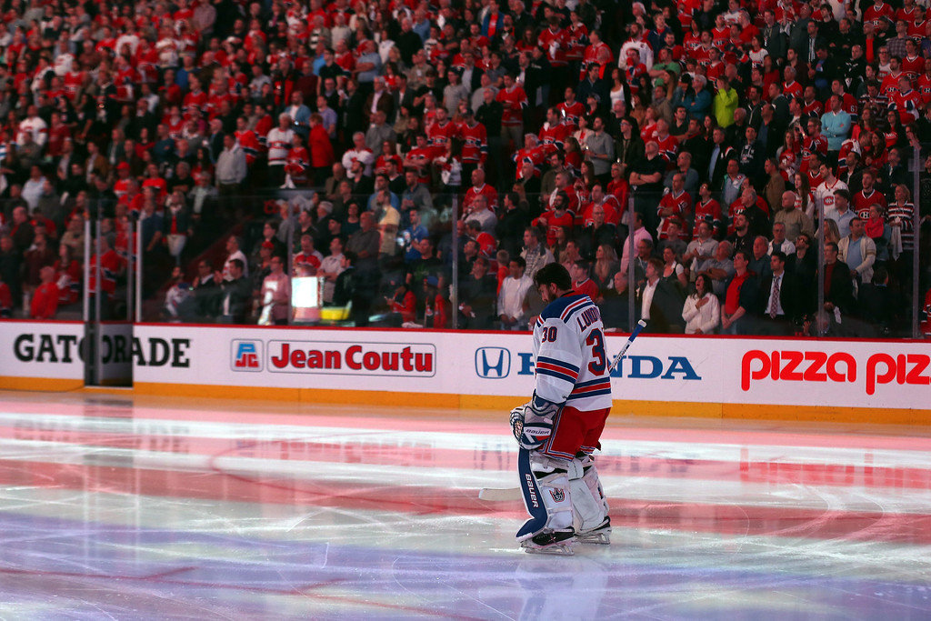 . Henrik Lundqvist #30 of the New York Rangers stands during the American national anthem prior Game Two of the Eastern Conference Final against the Montreal Canadiens during the 2014 Stanley Cup Playoffs at Bell Centre on May 19, 2014 in Montreal, Canada.  (Photo by Bruce Bennett/Getty Images)