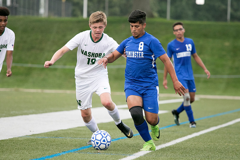 Leominster High School boys soccer played Nashoba Regional High School on Wednesday, September 4, 2019 at Doyle Field in Leominster. NRHS's Michael White and LHS's Thiago Cupertino fight for control of the ball. SENTINEL & ENTERPRISE/JOHN LOVE