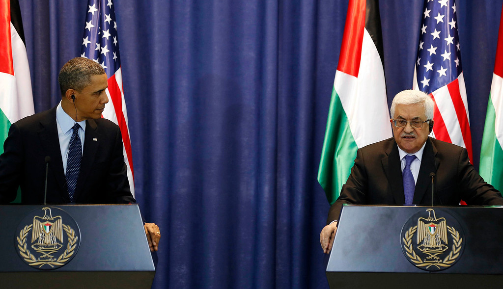 . U.S. President Barack Obama listens to Palestinian President Mahmoud Abbas during a news conference at the Muqata Presidential Compound in the West Bank City of Ramallah March 21, 2013.     REUTERS/Larry Downing