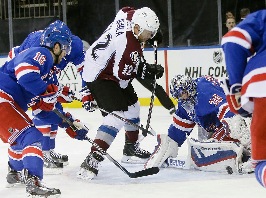. New York Rangers goalie Henrik Lundqvist (30), of Sweden, stops a shot on the goal as Colorado Avalanche\'s Jarome Iginla (12) attempts to score during the first period of an NHL hockey game Thursday, Nov. 13, 2014, in New York. (AP Photo/Frank Franklin II)