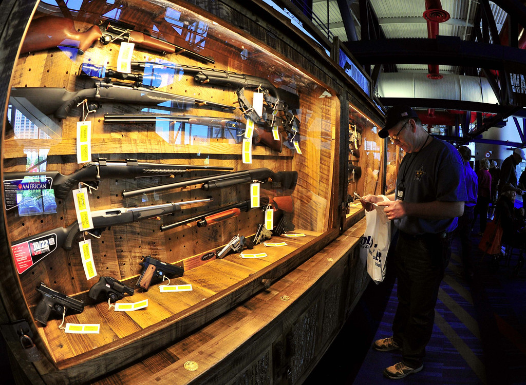 ". Some of several hundred weapons that will be raffled off, are displayed on the ""Wall of Guns\"" at the NRA (National Rifle Association) Convention May 4, 2013 in Houston, Texas.  KAREN BLEIER/AFP/Getty Images"