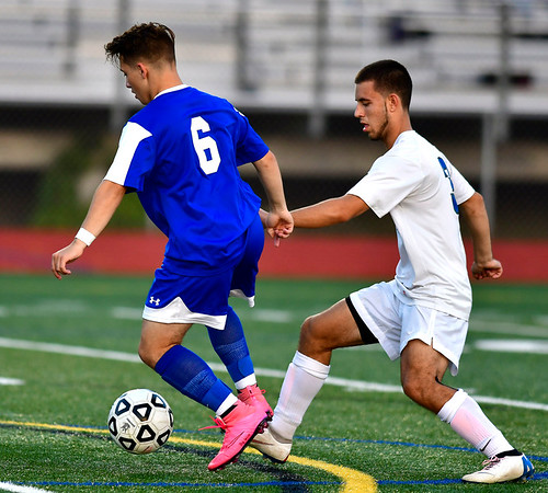 10/9/2018 Mike Orazzi | Staff Bristol Eastern's Connor Errato (6) and Southington's Colin Burdette (3) at BEHS Tuesday.