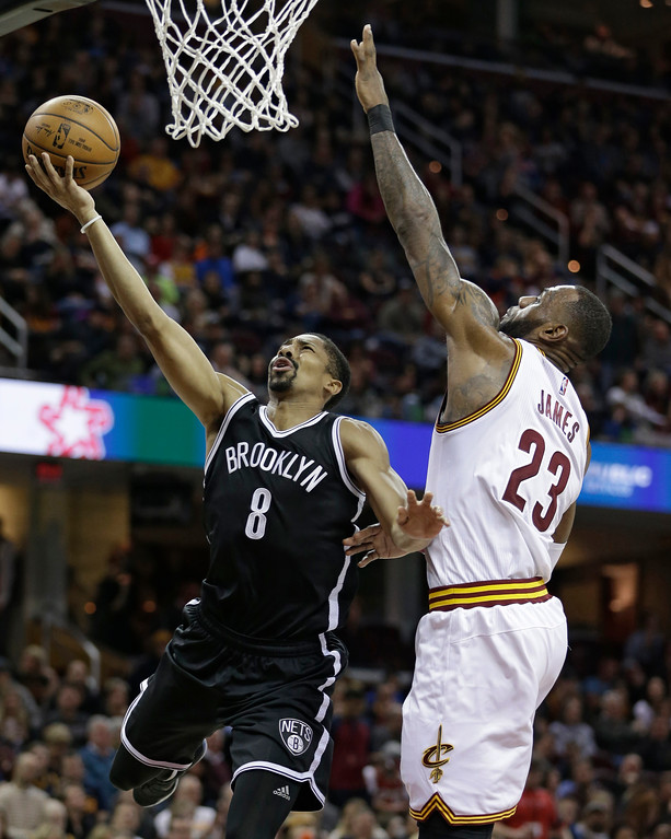 . Brooklyn Nets\' Spencer Dinwiddie (8) drives to the basket against Cleveland Cavaliers\' LeBron James (23) during the first half of an NBA basketball game, Friday, Jan. 27, 2017, in Cleveland. (AP Photo/Tony Dejak)