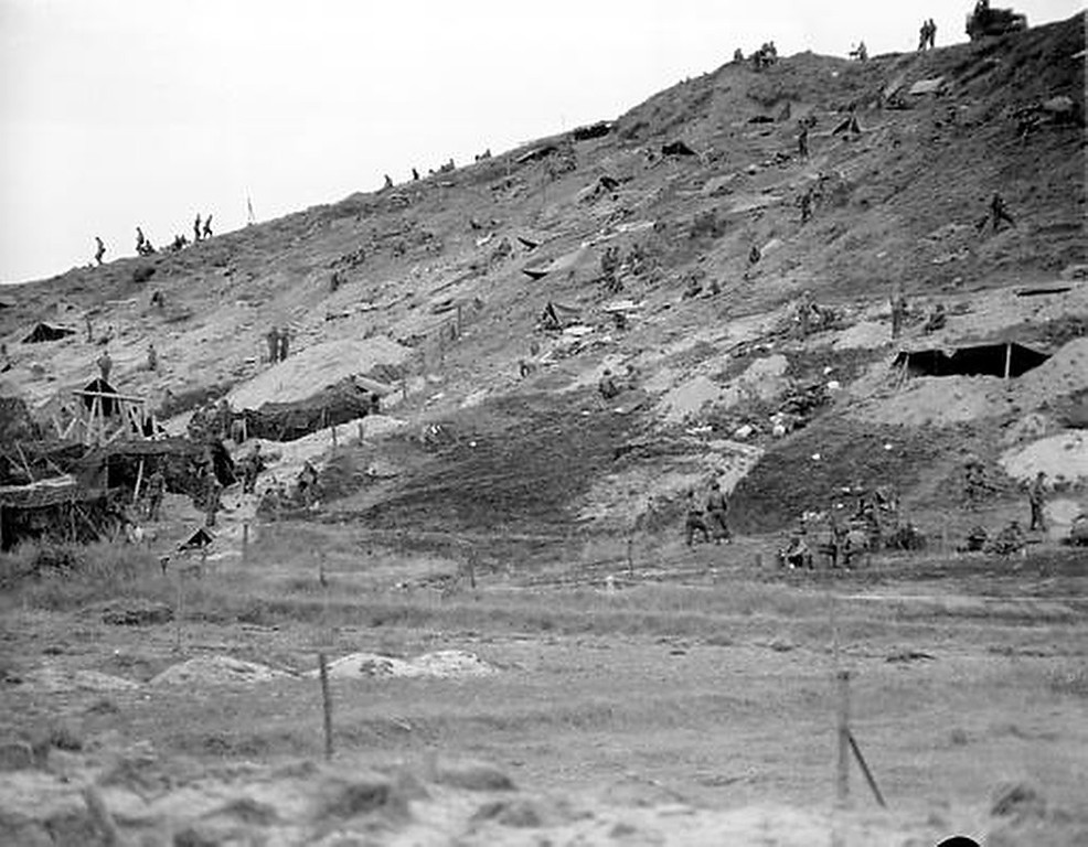 . Allied forces camp out in fox holes, caves and tents on this hillside overlooking the beach at Normandy, France, during the D-Day invasion in World War II.  (AP Photo/Bede Irvin)