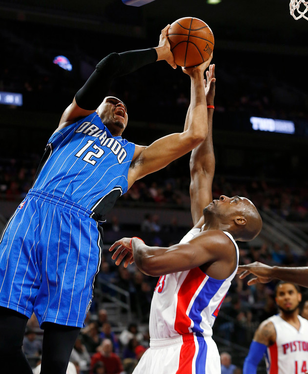. Orlando Magic forward Tobias Harris (12) shoots against Detroit Pistons forward Anthony Tolliver (43) in the first half of an NBA basketball game in Auburn Hills, Mich., Wednesday, Jan. 21, 2015. (AP Photo/Paul Sancya)