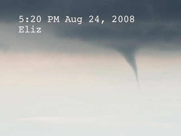 2 Tornadoes at the same time as seen from my back porch in Elizabeth, CO recently. I managed to grab my video camera and got a bunch of stills as well.