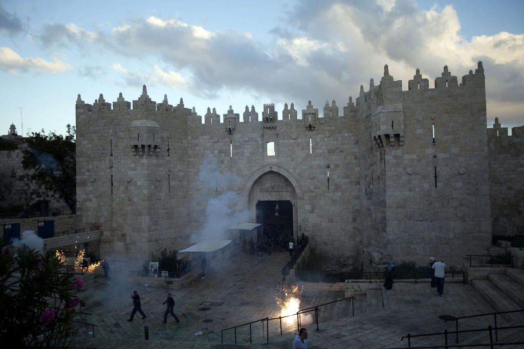. A general view shows Israeli security forces standing in the doorway of Damascus gate, which leads to Jerusalem\'s old city, after dispersing Palestinian protestors on September 24, 2013 who were demonstrating against the old city being fenced off due to the Jewish celebration of Sukkot. The Sukkot (Tabernacles) is a biblical Jewish holiday on which Hebrews make a pilgrimage to a temple in Jerusalem.  AHMAD GHARABLI/AFP/Getty Images