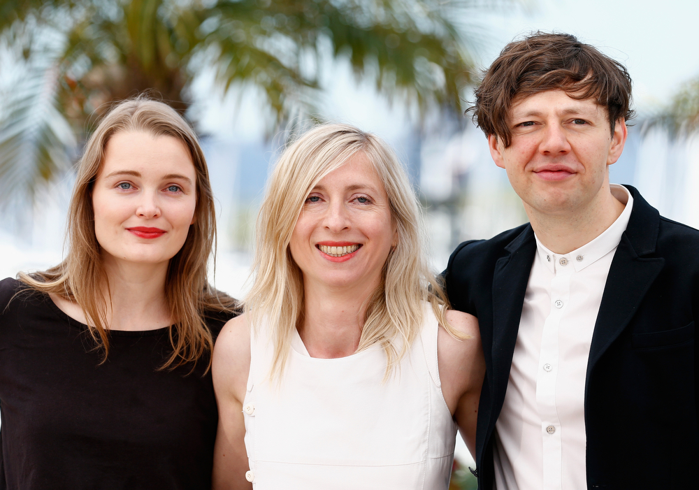 ". (L-R) Actress Birte Schnoeink, Director Jessica Hausner and actor Christian Friedel attend the ""Amour Fou\"" photocall at the 67th Annual Cannes Film Festival on May 16, 2014 in Cannes, France.  (Photo by Andreas Rentz/Getty Images)"