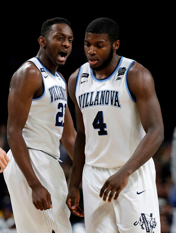 . Villanova forward Dhamir Cosby-Roundtree, left, reacts with teammate Eric Paschall during the second half against Michigan in the championship game of the Final Four NCAA college basketball tournament, Monday, April 2, 2018, in San Antonio. (AP Photo/David J. Phillip)