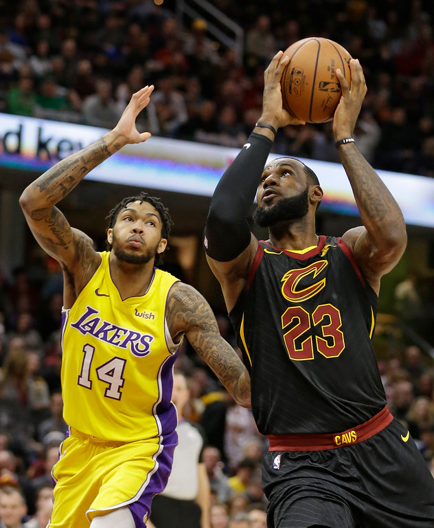 . Cleveland Cavaliers\' LeBron James (23) drives past Los Angeles Lakers\' Brandon Ingram (14) in the first half of an NBA basketball game, Thursday, Dec. 14, 2017, in Cleveland. (AP Photo/Tony Dejak)