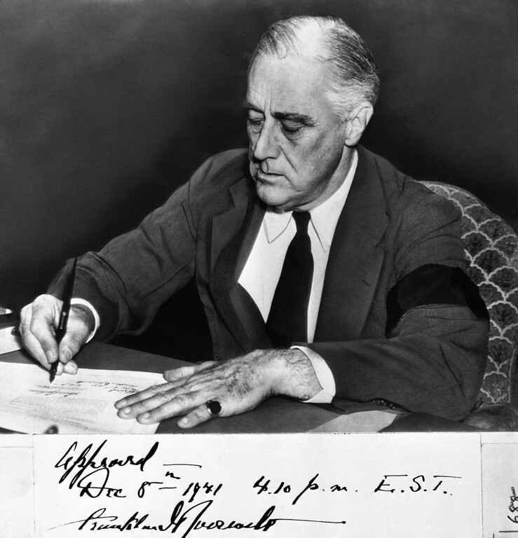 . 1941: Franklin D. Roosevelt. U.S. President Franklin D. Roosevelt signs declaration of war against Japan on Dec. 8, 1941. (AP Photo)