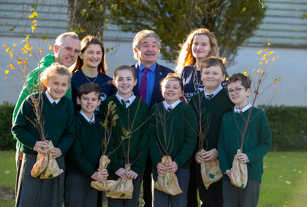 FREE TO USE IMAGE. Pictured during Science Week with WIT (Waterford Institute of Technology) by Calmast are Minister John Halligan T.D. with 5th Class at Sennans N.S., Kilmacow with pupils Una Cooper,Sam Cummins, Grace Laffan, Belle Carroll Kelly, Kiarian Langan, Joe Harney with T.Y students Jody Boyle and Lily Joy and Eoin Gill from Calmast WIT. Coillte and SFI sponsored 3500 trees for science week to combat climate change. Picture: Patrick Browne