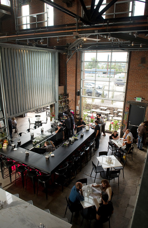 . The new inventive space in a former 19th century foundry, The Source, 3350 Brighton Blvd. in Denver, is beginning to open. The upscale taqueria, Comida, held a soft opening at the location on Monday August 26, 2013. It features giant bay windows that can open.  (Photo By Cyrus McCrimmon/The Denver Post )