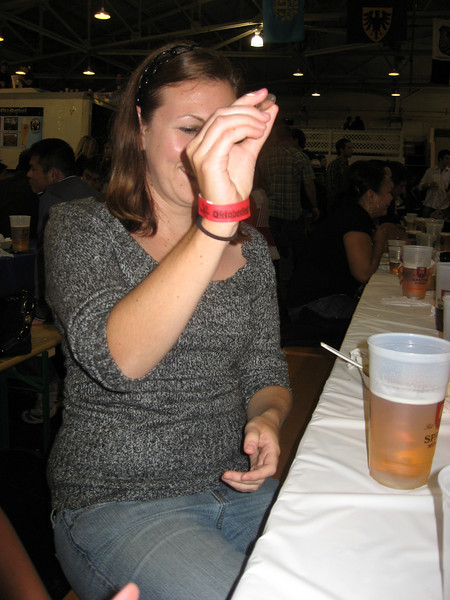 Kim trying to learn how to play Quarters at Oktoberfest by the Bay.