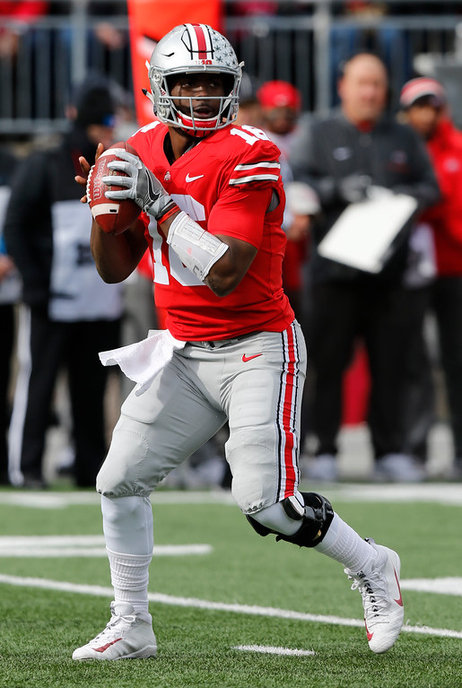 . Ohio State quarterback J.T. Barrett drops back to pass against Michigan State during the first half of an NCAA college football game Saturday, Nov. 11, 2017, in Columbus, Ohio. Ohio State beat Michigan State 48-3. (AP Photo/Jay LaPrete)