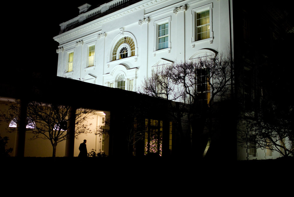 "Description of . Dec. 3, 2009 ""President Obama heads along the White House colonnade to the residence after leaving the Oval Office for the day."" (Official White House photo by Pete Souza)"