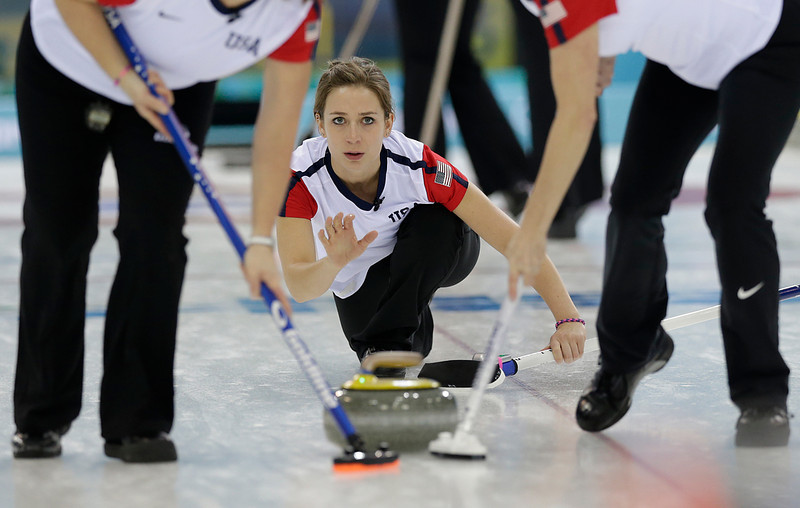 . Jessica Shultz of the United States gestures after releasing the rock for sweepers Debbie McCormick, left, and Ann Swisshelm, right, during the women\'s curling competition at the 2014 Winter Olympics, Tuesday, Feb. 11, 2014, in Sochi, Russia. (AP Photo/Wong Maye-E)