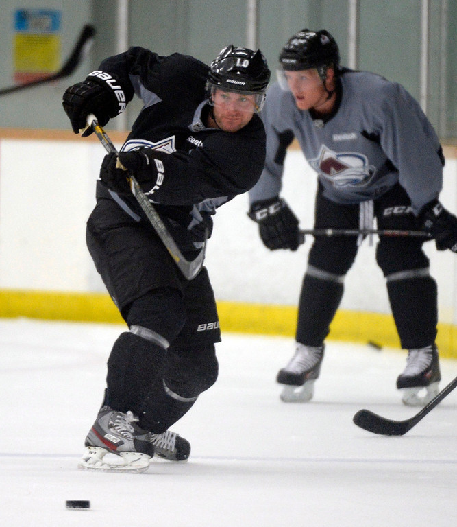 . Colorado Avalanche C Mark Olver (10) takes a shot during  practice September 9, 2013 at Family Sports Ice Arena. (Photo By John Leyba/The Denver Post)