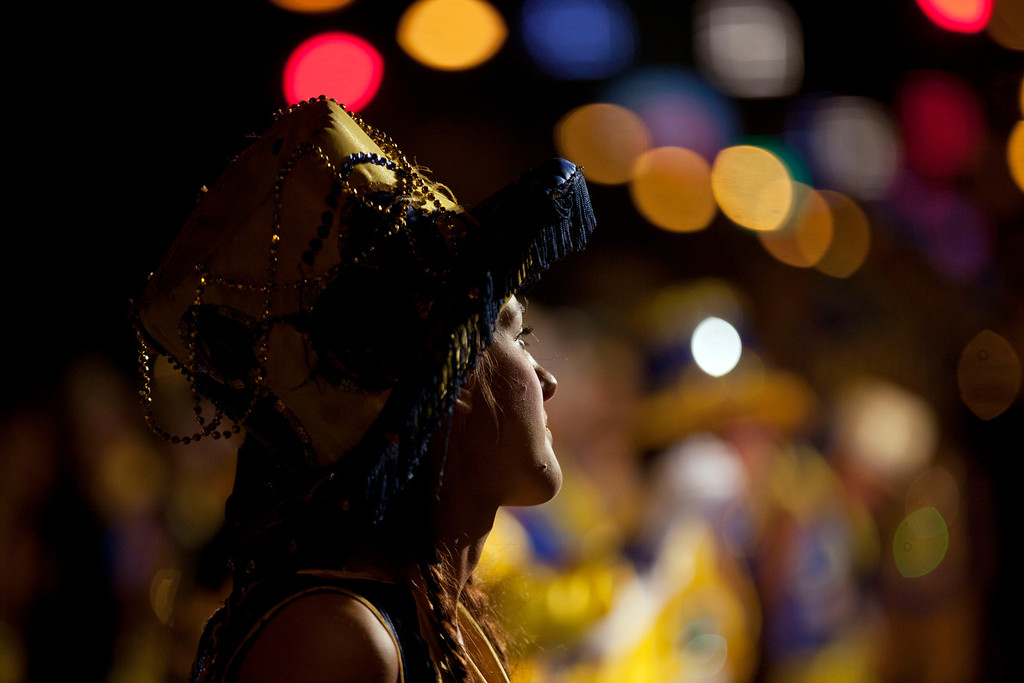 ". A member of the murga \""Los amantes de La Boca\"" participates in carnival celebrations in Buenos Aires, Argentina, Saturday, Feb. 2, 2013. (AP Photo/Natacha Pisarenko)"