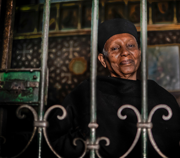 Unknown by much of the world, monks and nuns of the Ethiopian Orthodox Church, have for centuries quietly maintained the only presence by black people in one of Christianity's holiest sites,the Church of the Holy Sepulchre of Jesus Christ in Jerusalem.  Through the vagaries and vicissitudes of millennial history and landlord changes in Jerusalem and the Middle East region, Ethiopian monks have retained their monastic convent in what has come to be known as Deir Sultan or the Monastery of the Sultan for more than a thousand years.  Nune at the monastery of the Church of the Holy Sepulchre in Jerusalem, Israel, 2012.