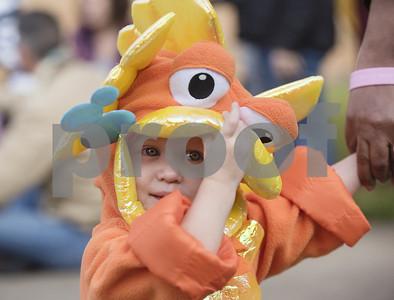 small-children-with-big-costumes-participate-in-kids-kaleidoscope-preschool-parade-at-pollard-united-methodist-church