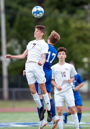 09/07/18 Wesley Bunnell | Staff Plainville boys soccer vs Bristol Central at Plainville High School on Friday evening. Bristol Central's Adam Jones (7) and Plainville's Nathan Cyr (17).