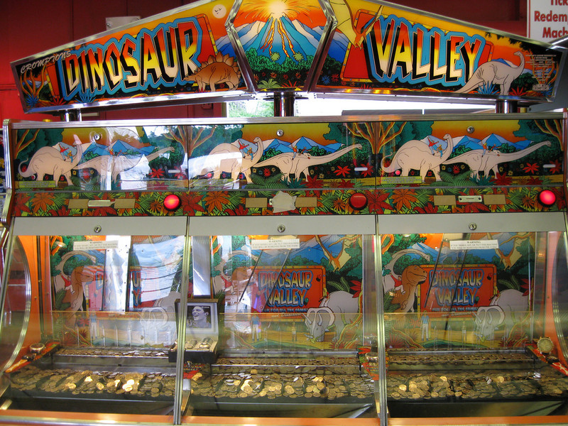 Dinosaur Valley is a coin pusher redemption game.