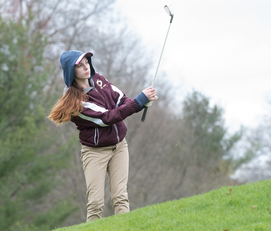 04/30/18 Wesley Bunnell | Staff Newington girls golf vs New Britain on Monday afternoon at Indian Hill Golf Club in Newington. New Britain's Kiley Griffin chips onto the green.