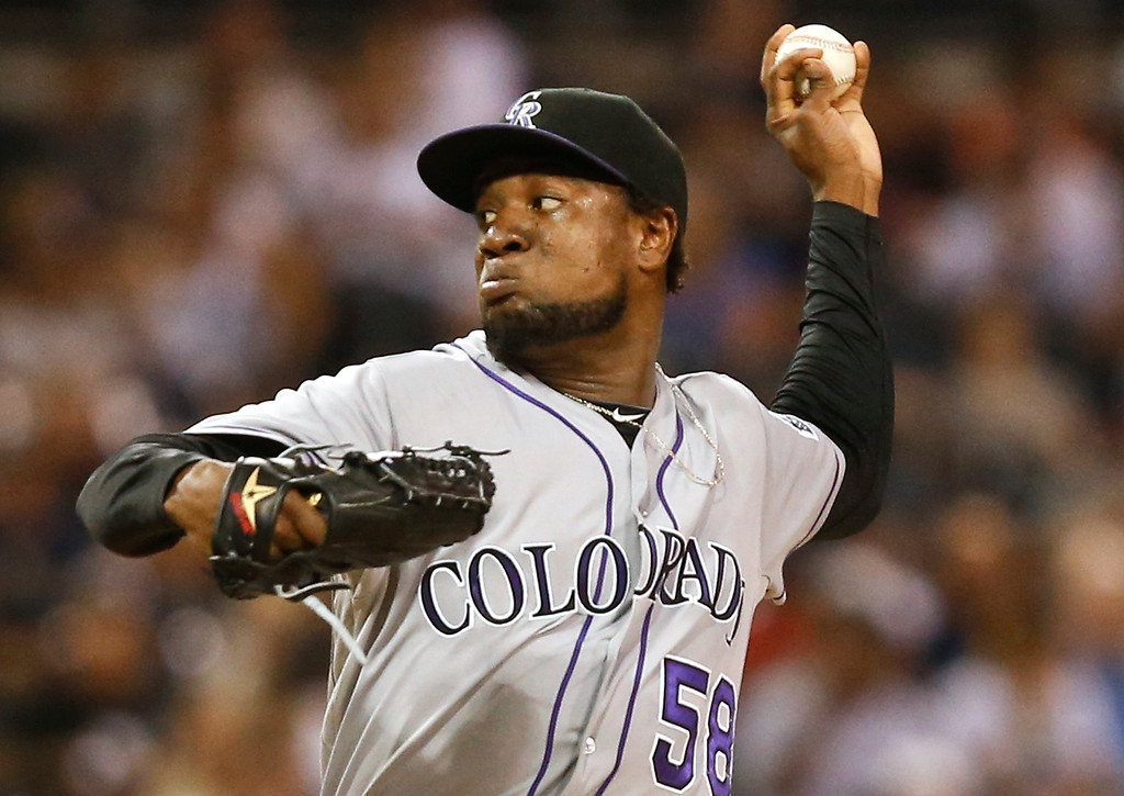 . Colorado Rockies starting pitcher Yohan Flande works against the San Diego Padres in the first inning of a baseball game Wednesday, Sept. 24, 2014, in San Diego.  (AP Photo/Lenny Ignelzi)