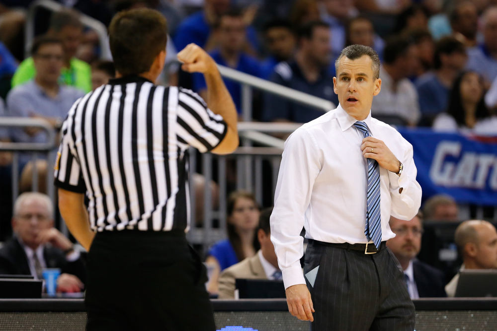 . Head coach Billy Donovan of the Florida Gators reacts in the first half while looking at the referee as the Gators are taking on the Pittsburgh Panthers during the third round of the 2014 NCAA Men\'s Basketball Tournament at Amway Center on March 22, 2014 in Orlando, Florida.  (Photo by Kevin C. Cox/Getty Images)