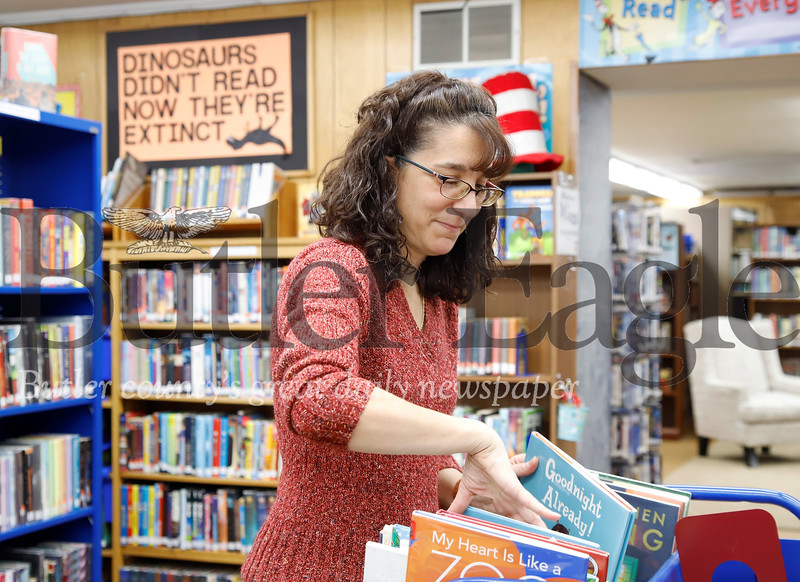Library director Jill Hambley sorts through books Wednesday at the Prospect Library. Seb Foltz/Butler Eagle 01/22/20