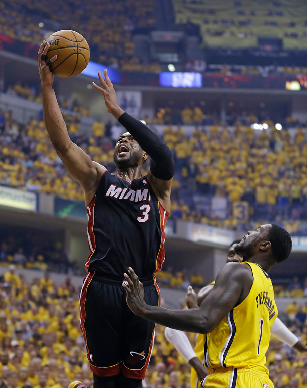 . Miami Heat\'s Dwyane Wade (3) puts up a shot against Indiana Pacers\' Lance Stephenson (1) during the first half of Game 2 of the NBA basketball Eastern Conference finals in Indianapolis, Tuesday, May 20, 2014. (AP Photo/Michael Conroy)