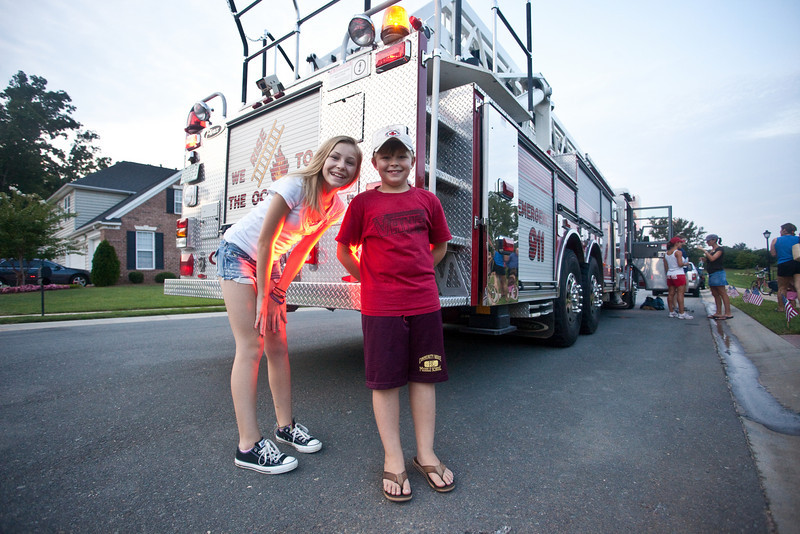 Kelly (age 13) and Noah (age 8) Reagan pose by the back of the ladder truck.