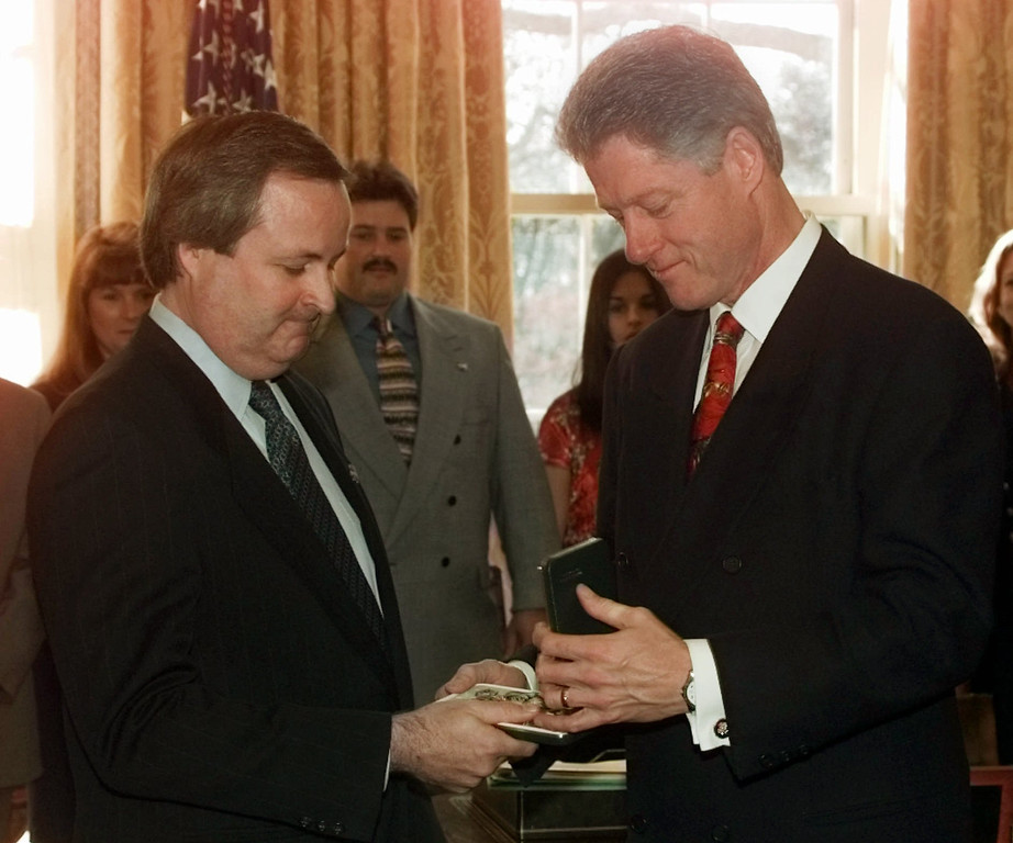 . President Clinton presents Edward White III, son of late Apollo 1 astronaut Lt. Col. Edward White II, with a Congressional Space Medal of Honor during a ceremony in the Oval Office of the White House Wednesday Dec. 17, 1997. White, along with fellow astronauts Gus Grissom and Roger Chaffee were killed Jan. 27, 1967 when a fire erupted on the launch pad during a preflight test for the Apollo 1 Moon mission. (AP Photo/Doug Mills)