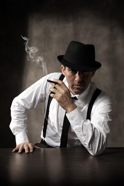 Fine art character portrait of actor Rafael Siegel as a noir detective, created by Denver photographer Jason Sinn.