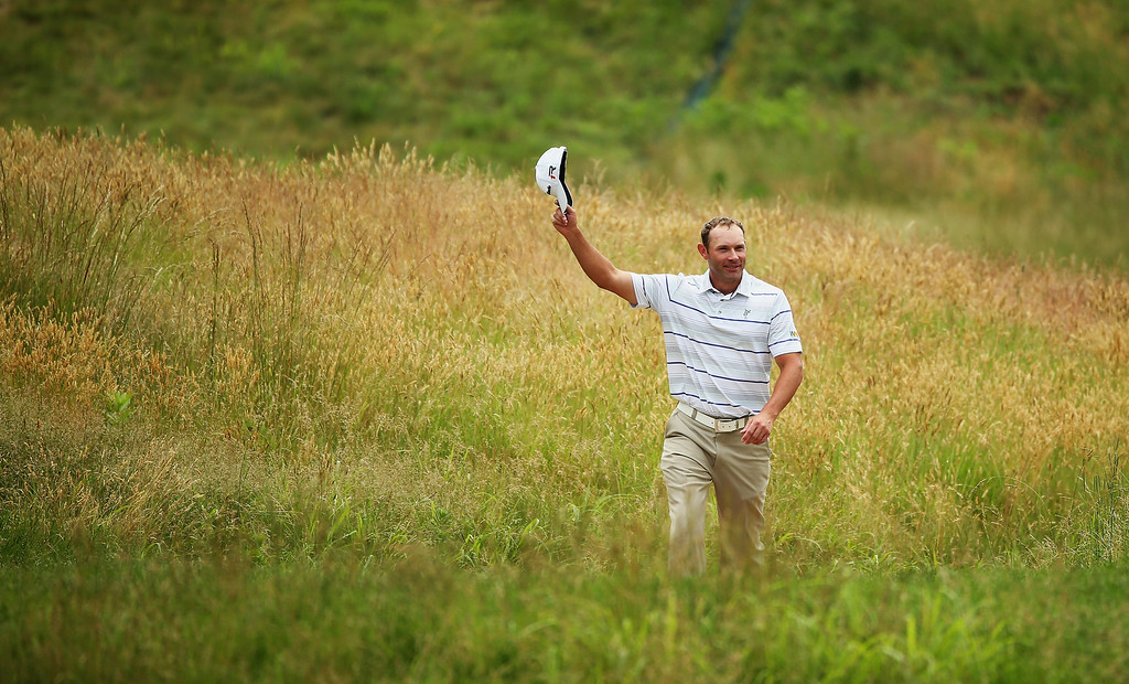 . ARDMORE, PA - JUNE 16:  Shawn Stefani of the United States waves after making a hole-in-one on the 17th hole during the final round of the 113th U.S. Open at Merion Golf Club on June 16, 2013 in Ardmore, Pennsylvania.  (Photo by Andrew Redington/Getty Images)