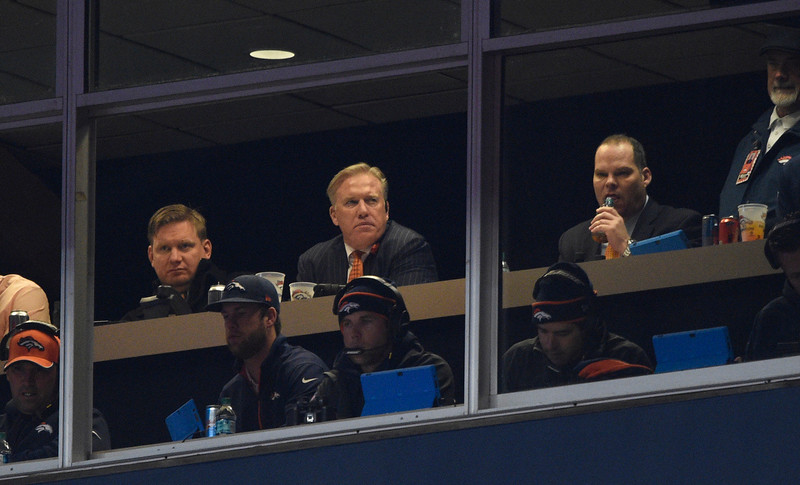. John Elway watches the fourth quarter from his box. The Denver Broncos played the Indianapolis Colts in an AFC divisional playoff game at Sports Authority Field at Mile High in Denver on January 11, 2015. (Photo by John Leyba/The Denver Post)