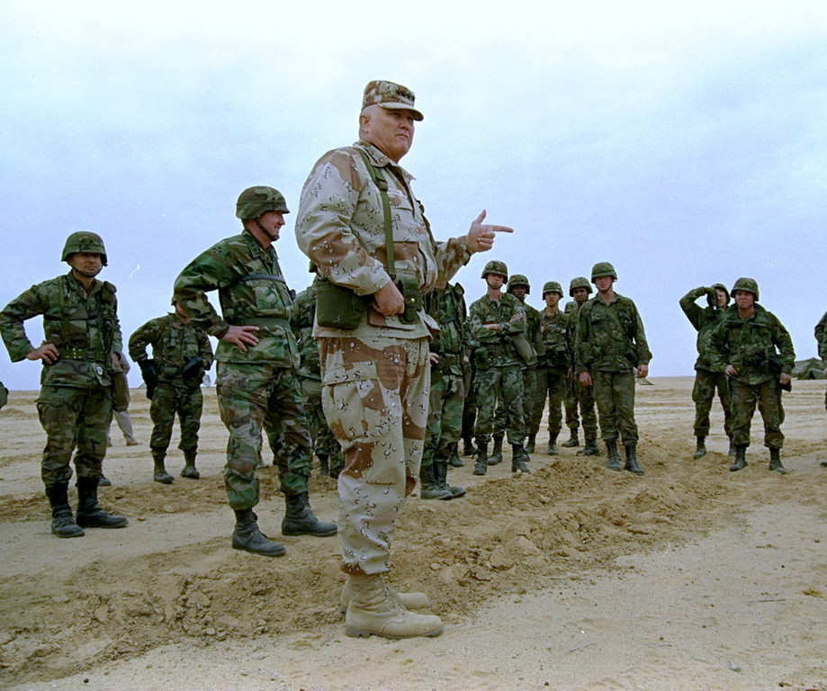 . Gen. H. Norman Schwarzkopf is shown at ease with his tank troops at Operation Desert Storm in Saudi Arabia, January 12, 1991.  (AP Photo/Bob Daugherty)