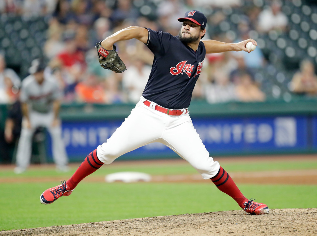 . Cleveland Indians relief pitcher Brad Hand delivers in the eighth inning of a baseball game against the Minnesota Twins, Tuesday, Aug. 28, 2018, in Cleveland. (AP Photo/Tony Dejak)