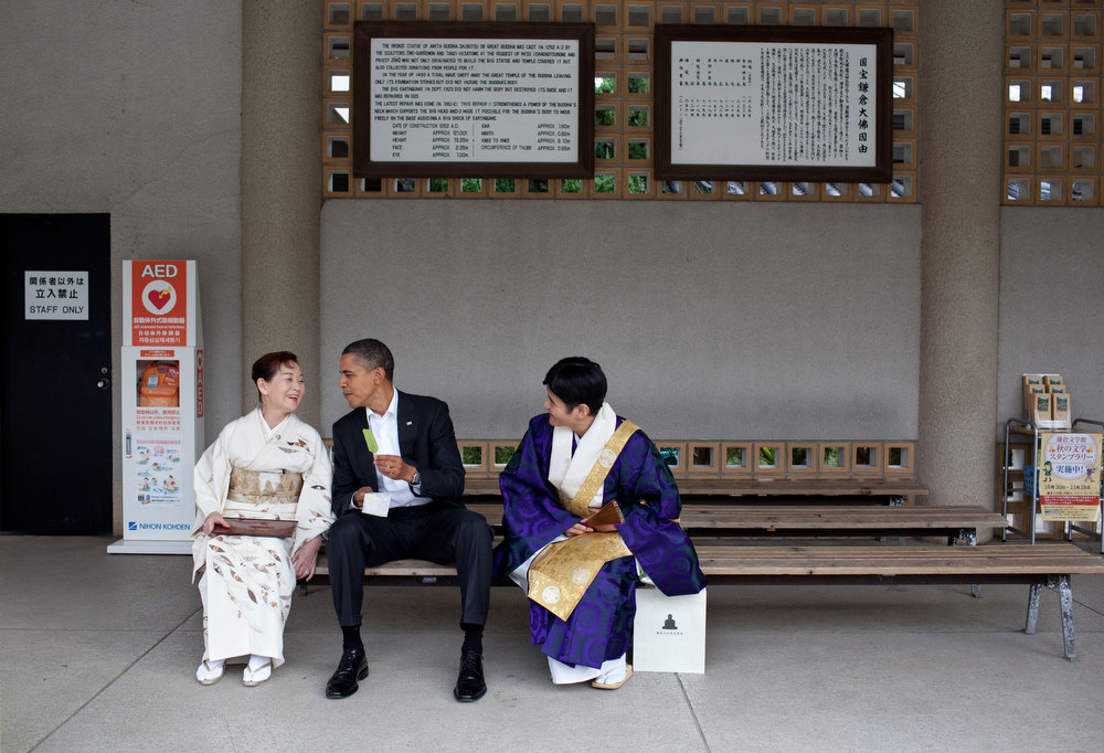 ". Nov. 14, 2010 ""Visiting the Great Buddha of Kamakura, in Japan, the President had a green tea ice cream bar with his hosts. He had visited this Buddha as a young child and said he remembered sitting in the exact same place having an ice cream bar.\"" (Official White House Photo by Pete Souza)"