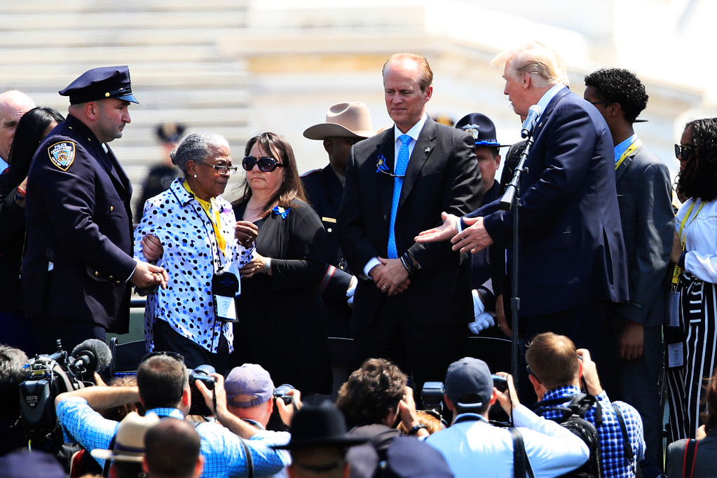 . President Donald Trump greets Adrianna Valoy, the mother of New York Police Department detective Miosotis Familia, who was killed in the line of duty, during the 37th Annual National Peace Officers\' Memorial Service on Capitol Hill in Washington, Tuesday, May 15, 2018. (AP Photo/Manuel Balce Ceneta)