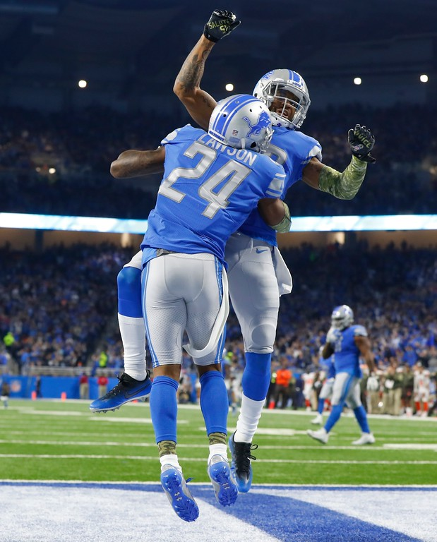 . Detroit Lions cornerback Nevin Lawson (24) leaps with Darius Slay after scoring on a 44-yard run after a Cleveland Browns fumble during the first half of an NFL football game, Sunday, Nov. 12, 2017, in Detroit. (AP Photo/Paul Sancya)