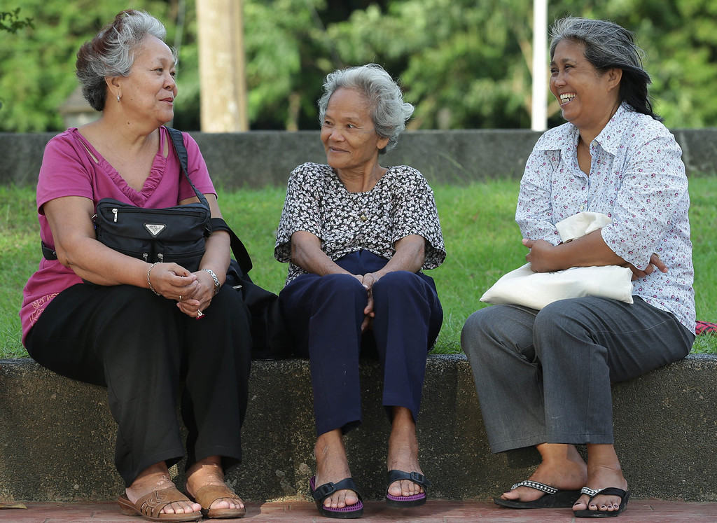 . Elderly Filipino women chat at Rizal Park, in Manila, Philippines on Sunday, Sept. 29, 2013. Much of the world is not prepared to support the ballooning population of elderly people, including many of the fastest-aging countries, according to a global study scheduled to be released Tuesday, Oct. 1, by the United Nations and an elder rights group. (AP Photo/Aaron Favila)