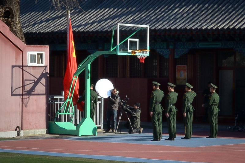 Film crew recording the flag ceremony