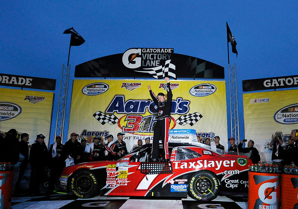 . Driver Regan Smith celebrates in Victory Lane after winning the NASCAR Nationwide Series auto race at the Talladega Superspeedway in Talladega, Ala., Saturday, May 4, 2013. (AP Photo/Rainier Ehrhardt)