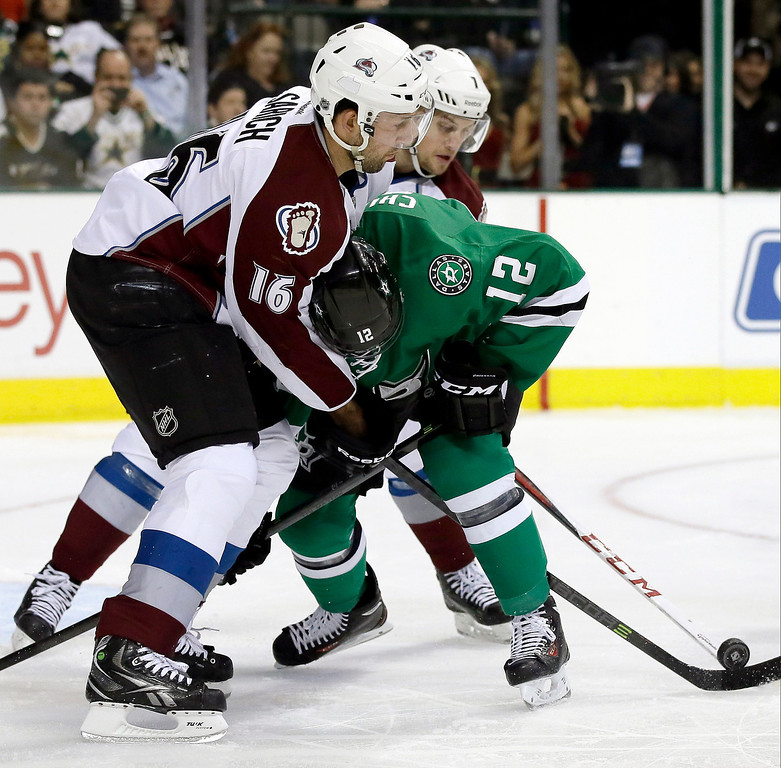 . Colorado Avalanche\'s Cory Sarich (16) and John Mitchell defend as Dallas Stars right wing Alex Chiasson (12) loses control of the puck in front of the net in the first period of an NHL hockey game, Tuesday, Dec. 17, 2013, in Dallas. (AP Photo/Tony Gutierrez)